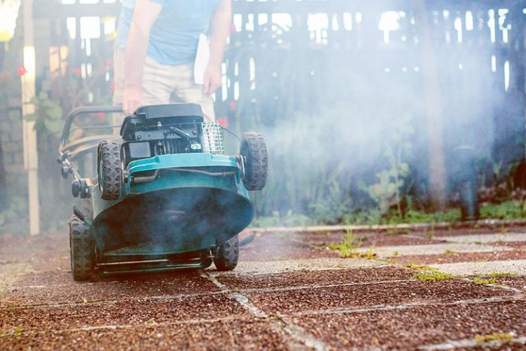 Lawn Mower Smoking: Reasons Why & How To Fix Them